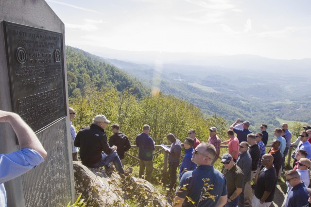 A group of 10th Combat Aviation Brigade, 10th Mountain Division (LI), Soldiers stops at a monument for Monte Altuzzo during a staff ride in Italy on September 30. The group was on a tour that retraced the history of their Division by visiting WWII battlefields and signifcant sites to gain a deeper understanding, appreciation, and connection to the Division. (U.S. Army photo by Spc. Thomas Scaggs) 170930-A-TZ475-046