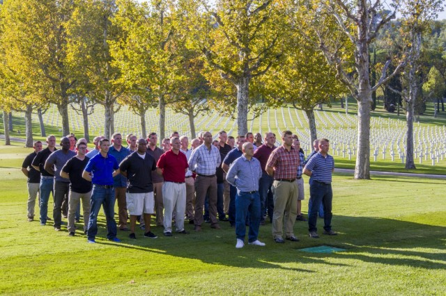 Soldiers from the 10th Combat Aviation Brigade, 10th Mountain Division (LI), stand in formation iin preparation for the flag's Retreat ceremony at the Florence American Cemetary and Memorial, Italy, on September 30. The group was on a tour that retraced the history of their Division by visiting WWII battlefields and signifcant sites to gain a deeper understanding, appreciation, and connection to the Division. (U.S. Army photo by Spc. Thomas Scaggs) 170930-A-TZ475-214