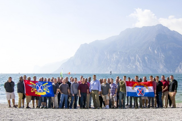 A group of Soldiers from the 10th Combat Aviation Brigade, 10th Mountain Division (LI), pose in front of Lake Garda, Italy, on October 2. The group was on a tour that retraced the history of their Division by visiting WWII battlefields and signifcant sites to gain a deeper understanding, appreciation, and connection to the Division. (U.S. Army photo by Spc. Thomas Scaggs)