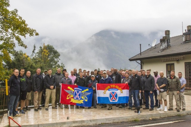 Soldiers with the 10th Combat Aviation Brigade, 10th Mountain Division (LI), pose beneath the cloudy peak of Mount Belvedere, Italy, on October 1. The group was on a tour that retraced the history of their Division by visiting WWII battlefields and signifcant sites to gain a deeper understanding, appreciation, and connection to the Division. (U.S. Army photo by Spc. Thomas Scaggs) 171001-A-TZ475-022