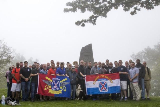 A group of Soldiers from the 10th Combat Aviation Brigade, 10th Mountain Division (LI), pose in front of a Division monument atop Mount Belvedere, Italy, on October 1.  The group was on a tour that retraced the history of their Division by visiting WWII battlefields and signifcant sites to gain a deeper understanding, appreciation, and connection to the Division. (U.S. Army photo by Spc. Thomas Scaggs) 171001-A-TZ475-036