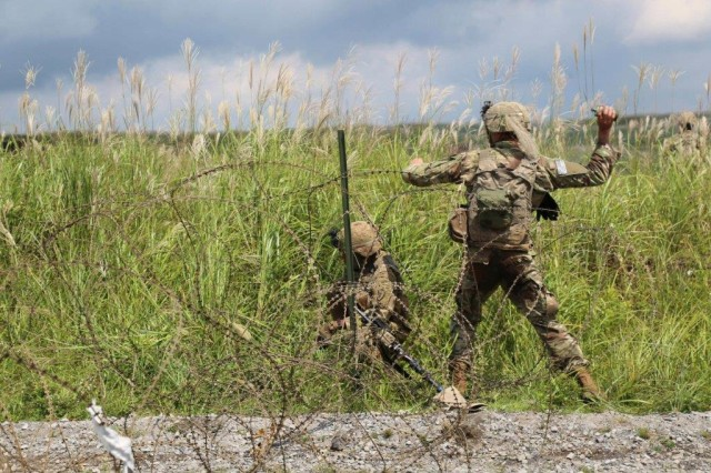 Soldiers attached to 1st Stryker Brigade Combat Team, 25th Infantry Division, conduct a