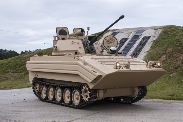 A mechanic completes testing on a M113A3/BMP-2 Opposing Forces Surrogate Vehicle at Anniston Army Depot. The depot recently completed overhaul of 14 of these training vehicles.