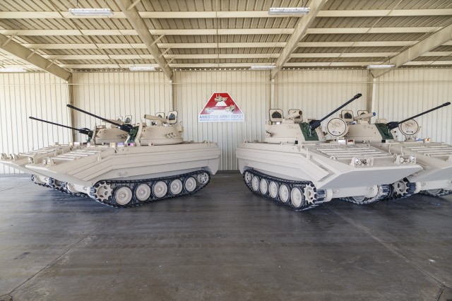A line of M113A3/BMP-2 Opposing Forces Surrogate Vehicles stand ready for shipping from Anniston Army Depot through DLA Distribution Anniston, Ala. The depot recently completed overhaul of 14 of these training vehicles, which are designed to look like Russian combat vehicles.