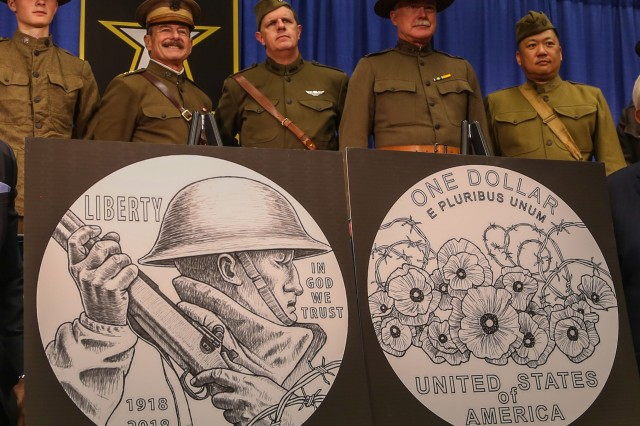 "World War I re-enactors stand behind the U.S. Mint's design for a commemorative silver dollar that will be released early next year. The actor second from the left depicts Gen. ""Blackjack"" Pershing, commander of the U.S. Expeditionary Force. The coin design was unveiled Oct. 9, 2017 at the Association of the U.S. Army Annual Meeting and Exposition."