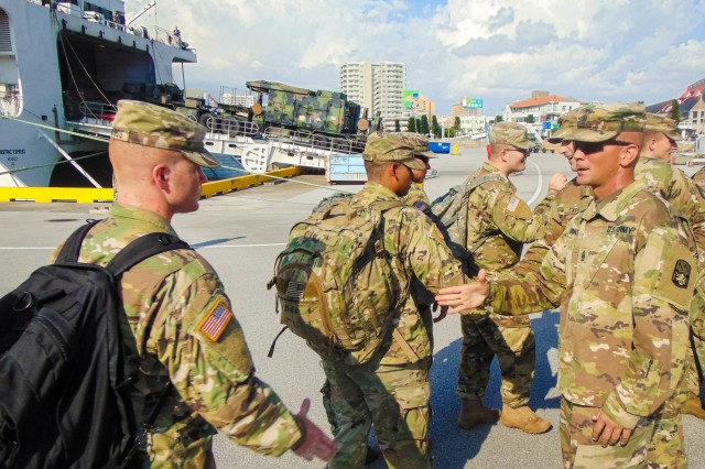 Command Sgt. Maj. Pinkham (right), 1st Battalion, 1st Air Defense Artillery command sgt. maj. greets his Soldiers after they redeployed from the Republic of Korea at Naha Military Port, Japan, Aug. 13.