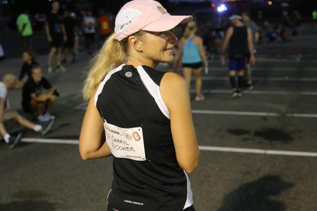 "Susanne Navis, wearing a ""Run to Honor"" bib"