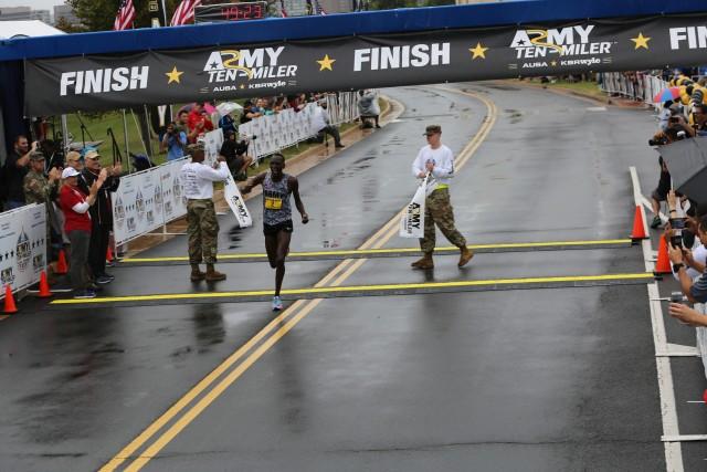 Spc. Haron Lagat crosses the finish line