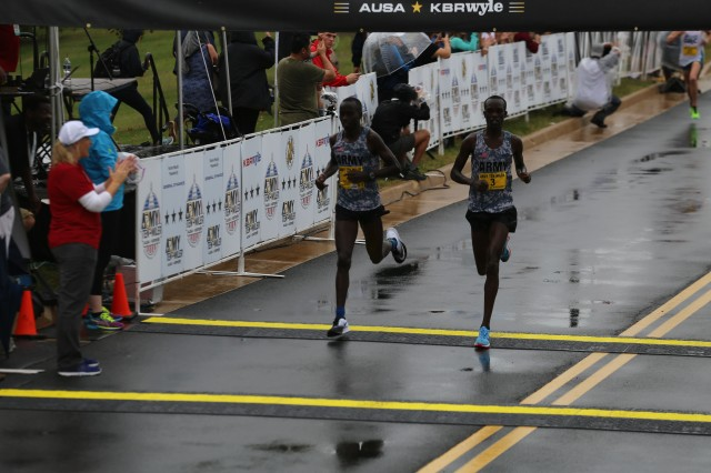 Battle-buddies Spc. Shadrack Kipchirchir and Spc. Leonard Korir finished fourth and fifth at the Army Ten-Miler Oct. 8, 2017. Their team won the International Cup.