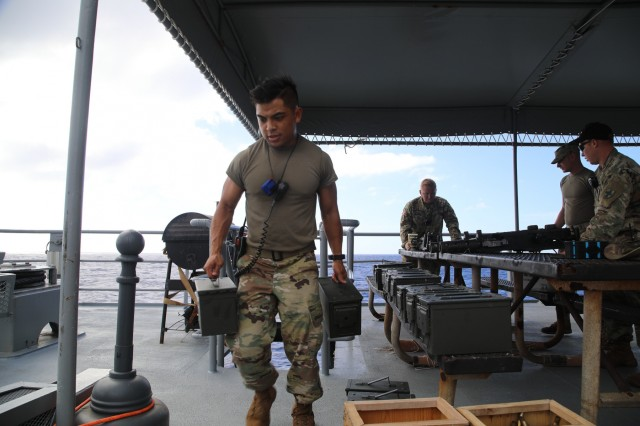 U.S. Army Sgt. James Munar, a Paloma, California native and a culinary specialist with the 605th Transportation Detachment, 8th Special Troops Battalion, 8th Theater Sustainment Command, helps prepare for the waterborne gunnery mission on board the Logistic Support Vessel the CW3 Harold A. Clinger (LSV-2), 40-miles south of Joint Base Pearl Harbor-Hickam, Hawaii on Oct. 4, 2017.