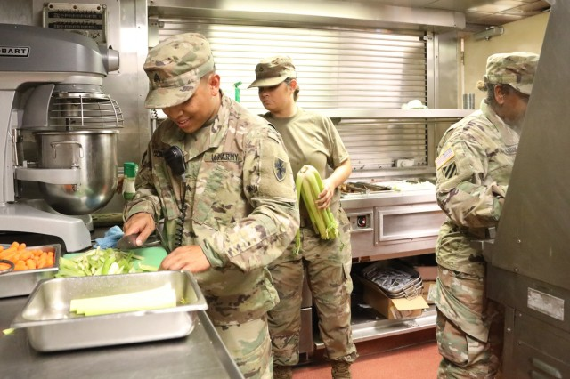 U.S. Army Sgt. James Munar, a Paloma, California native and a culinary specialist with the 605th Transportation Detachment, 8th Special Troops Battalion, 8th Theater Sustainment Command, helps prepare lunch with his Soldiers on board the Logistic Support Vessel the CW3 Harold A. Clinger (LSV-2) 40-miles south of Joint Base Pearl Harbor-Hickam, Hawaii on Oct. 4, 2017.