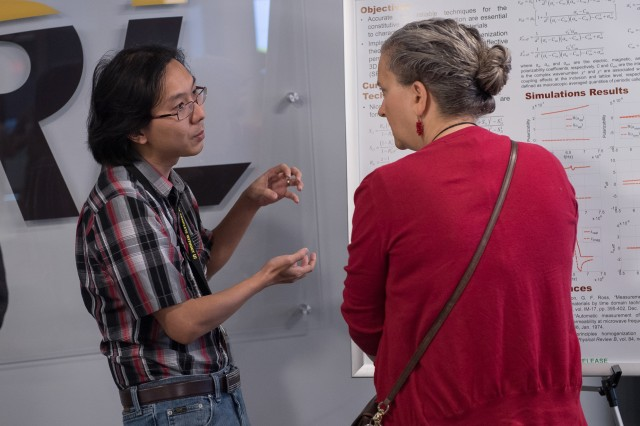 ARL Fellow Dr. Rose Pesce-Rodriguez speaks with a postdoc researcher during the poster session before casting her vote for best poster at the 2nd annual ARL Postdoc Research Day.