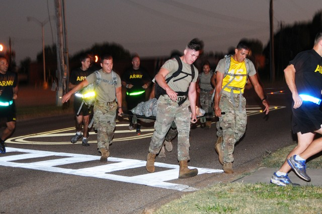Soldiers of the NCO Academy take part in an Iron Squad competition Oct. 3 during the day of remembrance for the Battle of Mogadishu.