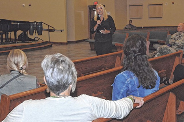 Susan Still speaks at the Main Post Chapel Tuesday during an ACS-sponsored Domestic Violence Awareness Month presentation.