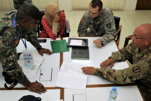 (From left to right) Maldives Capt. Mohamed Inayath, National Defence Force; Aminath Shaufa project officer, Maldives National Disaster Management Center; Chief Warrant Officer 3 Jarod Kendricl, aviation officer, Oregon National Guard and Army Maj. Gregory Ramirez, Medical Teaching Team Officer in Charge, Oregon National Guard, discuss disaster response plans during a table top exercise supporting the 2017 South Asia Pacific Resilience Disaster Response Exercise and Exchange in Dhaka, Bangladesh, 11 Oct. The Pacific Resilience series of exercises support U.S. Pacific Command's civil-military integration and Humanitarian Assistance/Disaster Relief capabilities. The South Asia Disaster Response Exercise and Exchange is just one of many exercises that ensure the United States is prepared to assist its global neighbors. (U.S. Army photo by Sgt. 1st Class Corey Ray)