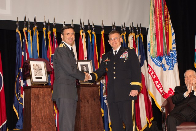Lieutenant General Dennis Gyllensporre, Chief of Defense Staff, Sweden, is congratulated by Lt. Gen. Michael Lundy, Commander of the Combined Arms Center and Fort Leavenworth and Commandant of the Command and General Staff College upon his induction into the CGSC International Hall of Fame on Oct. 12 at the Lewis and Clark Center on Fort Leavenworth, Kansas. Gyllensporre earned a Master's Degree and was the top international student in his CGSC Class of 2001. He went on to earn a PhD in Policy Analysis and Governance from Maastricht Graduate School of Governance in the Netherlands in 2010.