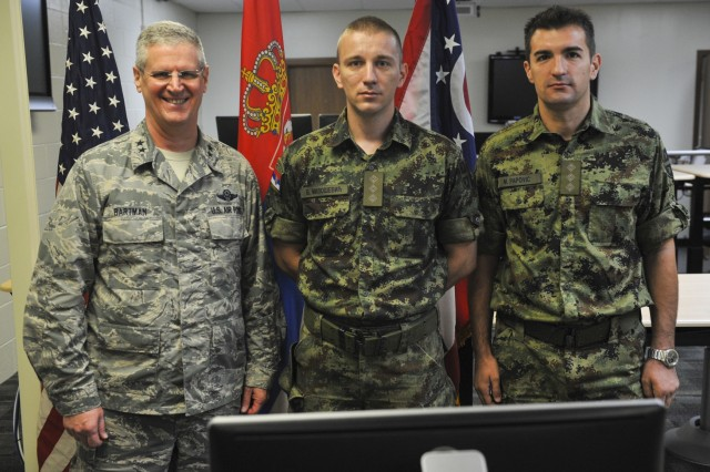 Maj. Gen. Mark E. Bartman (left), Ohio adjutant general, stands with members of the Serbian Armed Forces who participated in Cyber Tesla, a weeklong cyber defense exercise between the U.S. and Serbia, Sept. 14, 2017, at the Maj. Gen. Robert E. Beightler Armory in Columbus, Ohio. This was the second year for the exercise, which had elements in Serbia as well as Ohio.