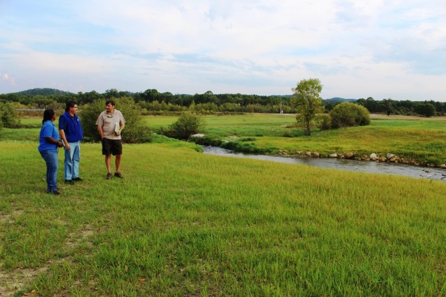 Fisheries Biologist John Noble (center) explains the work that was done on Silver Creek to remove the West Silver Wetland Dam at the site in summer 2017 with U.S. Fish and Wildlife Service personnel, Fisheries Biologist Louise Malden (left) and Project Leader Sam Finney (right). Mauldin and Finney visited Fort McCoy to see progress on stream-habitat and fish-passage improvement projects that have been completed in recent years. (U.S. Army Photo by Scott T. Sturkol, Fort McCoy, Wis.)