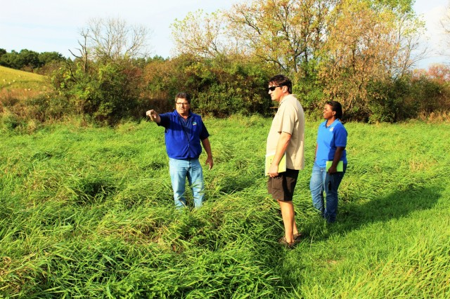 Fort McCoy Fisheries Biologist John Noble (left) explains the work that was done on Silver Creek to remove the West Silver Wetland Dam at the site in summer 2017 with U.S. Fish and Wildlife Service personnel, Fisheries Biologist Louise Malden (right) and Project Leader Sam Finney (center), at Fort McCoy, Wis. on Oct. 3, 2017. Mauldin and Finney visited Fort McCoy to see progress on stream-habitat and fish-passage improvement projects that have been completed in recent years. (U.S. Army Photo by Scott T. Sturkol, Fort McCoy, Wis.)