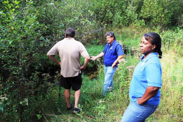 Fort McCoy Fisheries Biologist John Noble (center) explains the work that was done on Stillwell Creek for a stream-restoration project in 2014 with U.S. Fish and Wildlife Service personnel, Fisheries Biologist Louise Malden (right) and Project Leader Sam Finney (left) at Fort McCoy, Wis., on Oct. 3, 2017. Mauldin and Finney visited Fort McCoy to see progress on stream-habitat and fish-passage improvement projects that have been completed in recent years. (U.S. Army Photo by Scott T. Sturkol, Fort McCoy, Wis.)