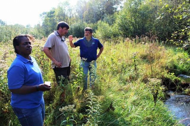 Fort McCoy Fisheries Biologist John Noble explains the work that was done on Stillwell Creek for a stream-restoration project in 2014 with U.S. Fish and Wildlife Service personnel, Fisheries Biologist Louise Malden and Project Leader Sam Finney at Fort McCoy, Wis., on Oct. 3, 2017. Mauldin and Finney visited Fort McCoy to see progress on stream-habitat and fish-passage improvement projects that have been completed in recent years. (U.S. Army Photo by Scott T. Sturkol, Fort McCoy, Wis.)