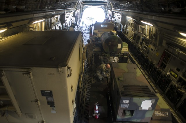 Airmen of the 121st Air Refueling Wing and the 164th Air Wing load equipment on a C-17 Globemaster for transportation to Puerto Rico October 11, 2017, at Rickenbacker Air National Guard Base, Ohio. The Ohio Army National Guard equipment belongs to the 137th Signal company which is providing communications support for hurricane relief efforts.