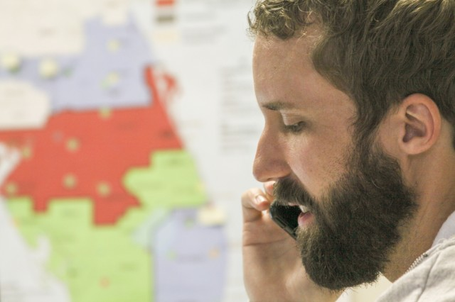 TAMPA, Fla. -- Charlie Thomason, the mission manager for Operation Blue Roof, takes a call at the Tampa Recovery Field Sept. 29, 2017. In disaster areas, Operation Blue Roof is a program for homeowners who have damage to their roofs. The program sends licensed contractors out to homes to cover the damage with fiber-reinforced plastic sheeting until residents can arrange repairs. As mission manager, Thomason was in charge of more than 280 Corps employees and 70,000 rolls of blue plastic sheeting.  (U.S. Army photo/Kerry Solan)
