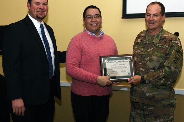 Hispanic Heritage Month Observance Oct. 5, 2017 at U.S. Army Dugway Proving Ground, Utah. Guest speaker (center) was Abraham Hernandez, education and health promotion coordinator for Centro Hispano of Provo, Utah. He was presented with a certificate of appreciation by Aaron Goodman, garrison manager (left), and Col. Brant D. Hoskins, commander of Dugway Proving Ground.