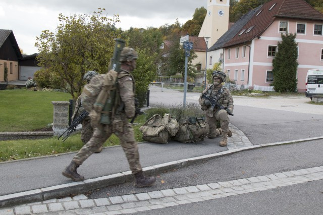 HOHENFELS, Germany (Oct. 9, 2017) - Paratroopers from the 173rd Airborne Brigade pull security while British paratroopers walk through a village nearby Hohenfels Training Area to reach their objective during Swift Response 17, Oct. 9. Swift Response 17, Phase II is an annual, U.S. Army Europe-led exercise focused on allied airborne forces' ability to quickly and effectively respond to crisis situations as an interoperable multi-national team. The exercise takes place at the Joint Multinational Readiness Center in Hohenfels, Germany, Oct. 2-20, 2017 and includes more than 6,000 participants from Bosnia-Herzegovina, France, Germany, Italy, Lithuania, Netherlands, Poland, Spain, the United Kingdom and the United States.