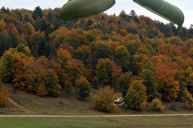 HOHENFELS, Germany (Oct. 10, 2017) - Multinational forces who make up the Combined-Joint Task Force during Swift Response 17, drop military vehicles from a C-130 on Hohenberg drop zone, Oct. 10. Swift Response 17, Phase II is an annual, U.S. Army Europe-led exercise focused on allied airborne forces' ability to quickly and effectively respond to crisis situations as an interoperable multi-national team. The exercise takes place at the Joint Multinational Readiness Center in Hohenfels, Germany, Oct. 2-20, 2017 and includes more than 6,000 participants from Bosnia-Herzegovina, France, Germany, Italy, Lithuania, Netherlands, Poland, Spain, the United Kingdom and the United States.