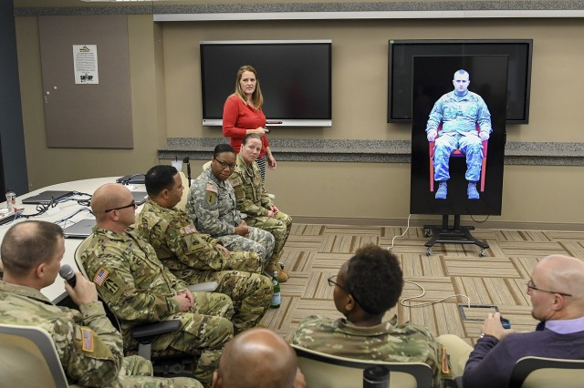 Digital Survivor of Sexual Assault project lead Stacy Johnson facilitates a sessions of Sexual Harassment/Assault Response and Prevention (SHARP) Academy students interacting with a virtual avatar of Army Spc. Jarett Wright, who was hazed and sexually assaulted while deployed to Iraq in 2010. Using Google voice recognition software, DS2A allows Soldiers and Department of the Army Civilians to have an immersive and interactive conversation with a survivor of sexual abuse.
