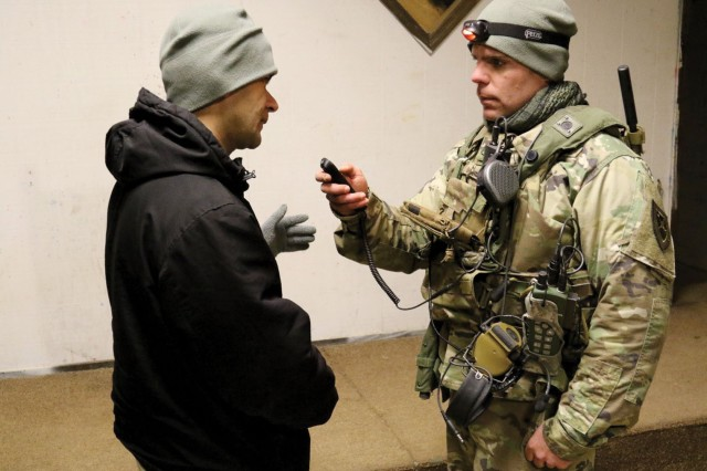 A Soldier and a role-player standing in for an Arabic-speaking local test MFLTS twoway speech translation app at the Army Expeditionary Warrior Experiment (AEWE) 2016 at Fort Benning, Georgia. AEWE is the U.S. Army Training and Doctrine Command's live, prototype experimentation campaign. (Photo by Tracy Blocker, MFLTS Product Office)