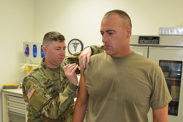 ANSBACH, Germany -- Garrison Command Sgt. Maj. Derek Cuvellier (pictured, right) stopped in at the Ansbach Clinic on Urlas Kaserne, Wednesday, Oct. 18 to receive his yearly flu shot. All active duty Soldiers are scheduled to receive the shot this week at the Grip Training Center on Bismark Kaserne, with Rotational Soldiers scheduled for vaccination on Stork Barracks Oct. 23 and 27. The Ansbach Health Clinic encourages all community members to avoid delay in making appointments to get the preventive shot. Shots will be available at the Ansbach Clinic on a walk-in basis or all community members (incl. Retirees. DoD Civilians, Active Duty family members and contractors) from 1 to 4 p.m. beginning 15 November. To learn more about the people and facilities of the U.S. Army Garrison Ansbach (USAG Ansbach) and the people they support in Ansbach, Katterbach and Illesheim, visit the community website at http://ansbach.army.mil