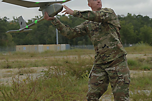 Staff Sgt. Justin Seeley, 3rd Battalion, 52nd Infantry Regiment, 1st Security Force Assistance Brigade, launches a RQ-11B Raven unmanned aircraft system Oct. 16, 2017, on Kelley Hill on Fort Benning, Georgia. Select 1st SFAB Soldiers were chosen to train on the UAS and pass the training along to their fellow Soldiers. Soldiers interested in joining the SFAB should contact their branch manager. (U.S. Army photo by Spc. Noelle E. Wiehe, 50th Public Affairs Detachment, 3rd Infantry Division public affairs)