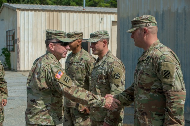 Gen. Robert Abrams, U.S. Army Forces Command commanding general, speaks with Soldiers from the 1st Security Force Assistance Brigade during a round-table discussion at the 1st SFAB Headquarters on post Sept. 15.  The 1st SFAB was officially stood up last month and was designed to rapidly deploy into a theater of operations in support of a combatant commander to work with, train, advise, and assist partner nation security forces in logistics, communications, maneuver strategies, and any other additional areas that require assistance. (Photos by Patrick A. Albright, MCoE Public Affairs Photographer)