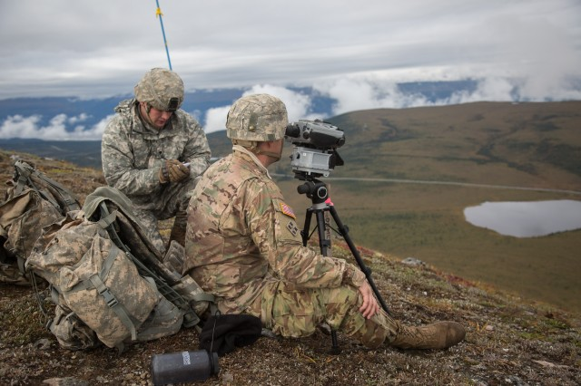Sgt. Gregory W. Caplan (left) and Spec. Joel C. Lemmon, Soldiers from Battery D, 2nd Battalion, 8th Field Artillery Regiment, get ready to transmit a call for fire using a Joint Effects Targeting System Target Laser Designation System (JETS-TLDS) on the top of Donnelly Dome at the Cold Regions Test Center, Fort Greely, Alaska.