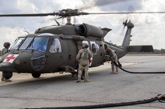 Petroleum supply specialists of the 3rd Squadron, 17th Cavalry Regiment, 3rd Combat Aviation Brigade, fuel a medevac helicopter during an exercise at Fort Stewart, Ga., in February 2017. The brigade recently underwent a General Services Administration survey designed to improve fuel quality and safety.