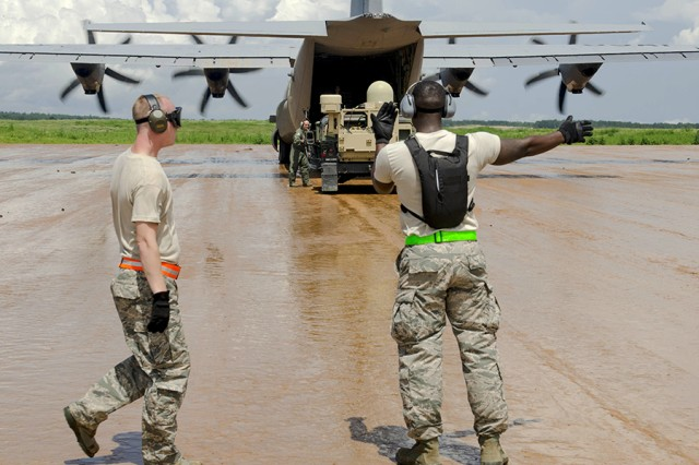 Airmen with the 46th Aerial Port Squadron, Dover Air Force Base, Delaware, along with Soldiers from the 3rd Brigade Combat Team, 82nd Airborne Division, unload humvees from a C-130 Hercules aircraft on Geronimo Drop Zone on Aug. 19, 2016, during an exercise at the Joint Readiness Training Center, at Fort Polk, La.