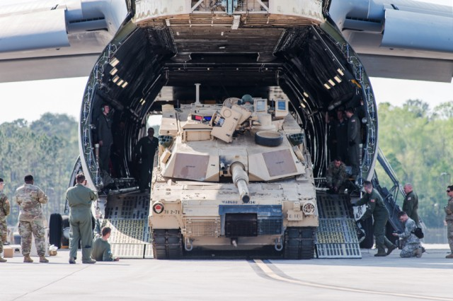 Soldiers of the 2nd Battalion, 7th Infantry Regiment, 1st Armored Brigade Combat Team, 3rd Infantry Division, load an Abrams tank onto a C-5 Galaxy aircraft at Hunter Army Airfield, Ga., on March 28, 2017.