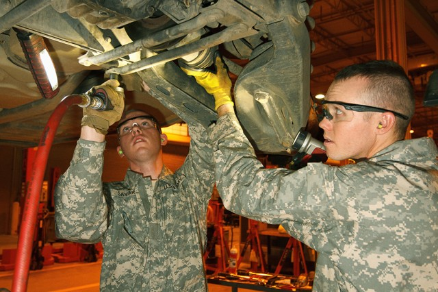 Pvt. Adam J. Savard and Pvt. Dakota S. Bohl, Arizona Army National Guard, remove the half-shaft on a humvee during an inspection service on March 14, 2017, at the TACOM Fleet Management Expansion Tactical Vehicle Division at Fort Benning, Ga.