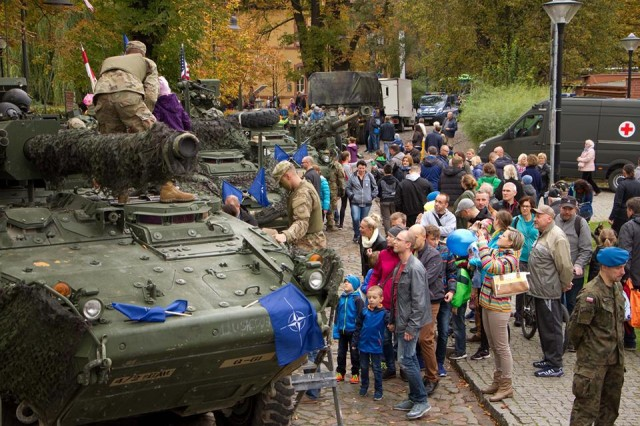 Soldiers from the 3rd Squadron, 2d Cavalry regiment participate in NATO Day in Bydgoszcz, Poland, Oct. 14, 2017. The Wolfpack Squadron provided static displays of weapon systems and military vehicles for the local community.