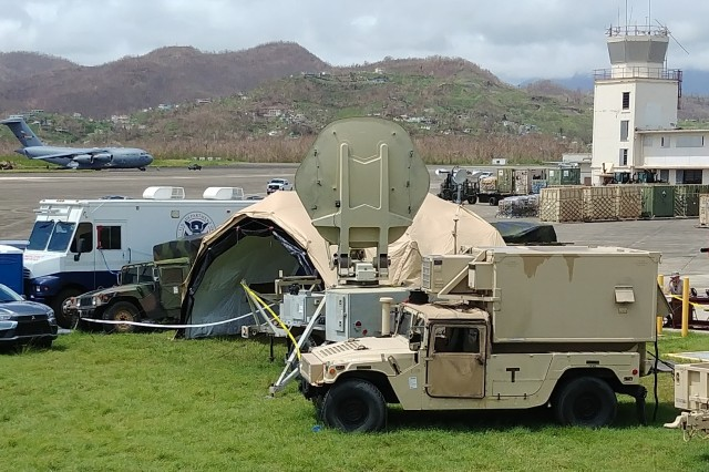 The Army's 63rd Expeditionary Signal Battalion (ESB), 35th Signal Brigade's organic Warfighter Information Network-Tactical (WIN-T) equipment (WIN-T Satellite Transportable Terminal seen center with Joint Network Node the lower right vehicle) is the only source of communications for the air traffic control tower at the Rafael Hernández Airport in Aguadilla, on October 5, 2017.