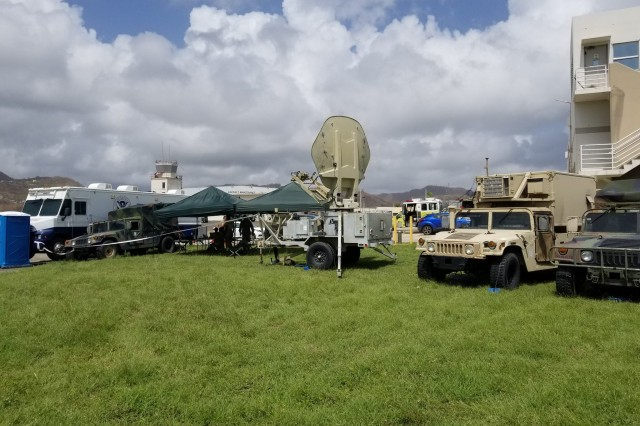 The 63rd Expeditionary Signal Battalion (ESB) uses organic Tactical Network satellite equipment, including this Satellite Transportable Terminal (STT) center and Joint Network Node (center right vehicle), in September 2017 to provide critical communications in Puerto Rico following Hurricane Maria.