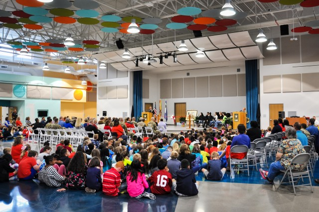 "Col. Gary ""Eddie"" Gillon Jr., Chief of Staff, 1st Sustainment Command, Fort Knox, Kentucky addresses the audience comprised of students, faculty, and stakeholders during the Kingsolver Elementary School Ribbon Cutting Ceremony held Sept. 14, 2017."