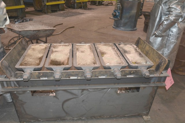 Re-melted tin affected with tin pest is poured into ingot molds at Rock Island Arsenal Joint Manufacturing and Technology Center, Rock Island, Illinois.