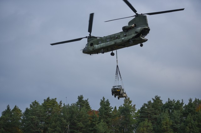 HOHENFELS, Germany -- Dutch soldiers conduct sling load operations for Exercise Swift Response 17, Phase 2 (SR 17-2) on Oct. 9th, 2017. SR 17-2 is an annual, U.S. Army Europe-led exercise focused unallied airborne forces' ability to quickly and effectively respond to crisis situations as an interoperable multi-national team. The exercise takes place at the JMRC in Hohenfels, Germany. (Photo by Sgt. David Vermilyea)