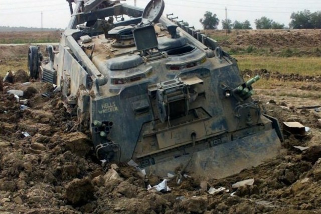 Pictured is an M88 Armored Recovery Vehicle bogged down in soft soil, one of the environmental challenges that the U.S. Army Cold Regions Research and Engineering Laboratory is addressing for the Marine Corps Systems Command. (Photo courtesy of Jared Oren, ERDC-CRREL)