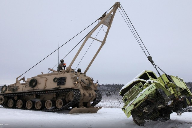 An M88 Armored Recovery Vehicle lifts a truck on snow. Snow and ice can render the ARV ineffective in recovery operations. (Photo courtesy of Greg Netardus, U.S. Army Cold Regions Test Center)