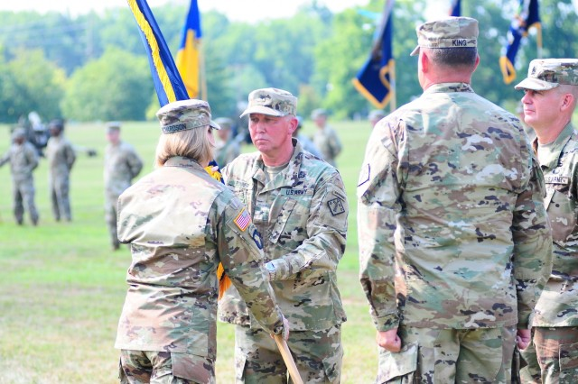 Lt. Gen. Laura J. Richardson, deputy commanding general of the U.S. Army Forces Command, passes the 20th Chemical, Biological, Radiological, Nuclear and Explosives (CBRNE) Command colors to Brig. Gen. James E. Bonner, incoming commander, during a change of command and retirement ceremony on July 19 at McBride Parade Field in Aberdeen Proving Ground, Md. The first half of the ceremony was the change of command where Brig. Gen. William E. King IV, out-going commander of the 20th CBRNE Command, relinquished his role as commander. The 20th CBRNE Command is a highly-technical, special purpose, expeditionary formation of approximately 4,000 Soldiers and 225 Civilians posted across 16 States and 19 installations. The 20th CBRNE Command is comprised of 85 percent of the Army's active component CBRN and Explosive Ordnance Disposal (EOD) forces and was organized specifically to consolidate mission command of these special purpose CBRNE assets under one operational headquarters within U.S. Army Forces Command.