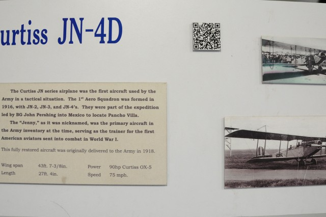 A plaque accompanying the Curtiss JN-4D Jenny on display in the U.S. Army Aviation Museum gives a brief glance into the aircraft's rich history.